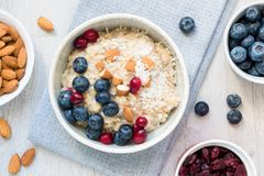 Healthy Breakfast Oatmeal Porridge Bowl with Fruits and Nuts Top View royalty free stock photos