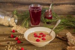 Healthy breakfast, Oatmeal porridge with raspberries and beverag Royalty Free Stock Images
