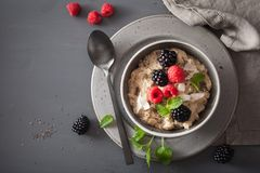 Healthy breakfast oatmeal porridge with raspberry blackberry Royalty Free Stock Photography