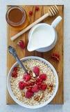 Healthy breakfast - Oatmeal, yogurt, fresh fruit, honey Stock Images