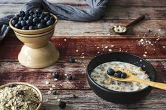Healthy breakfast with oats, blueberries and muesli royalty free stock photography