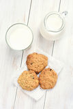 Healthy breakfast oats cookies and milk Royalty Free Stock Photos