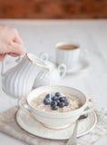 Healthy breakfast: oats porridge with coffee Royalty Free Stock Photo