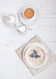 Healthy breakfast: oats porridge with coffee Stock Photo