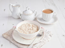 Healthy breakfast: oats porridge with coffee Stock Images