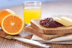 Healthy Breakfast. With orange jam toast and juice Stock Photos