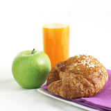 Healthy Breakfast with orange juice croissant and apple Royalty Free Stock Photo