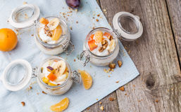 Healthy breakfast overnight oats with fresh fruit in a glass jar Royalty Free Stock Images