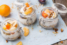 Healthy breakfast overnight oats with fresh fruit in a glass jar Royalty Free Stock Photography
