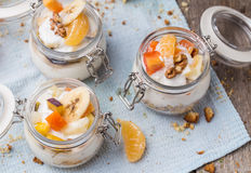 Healthy breakfast overnight oats with fresh fruit in a glass jar Stock Photography