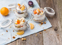 Healthy breakfast overnight oats with fresh fruit in a glass jar Stock Photos
