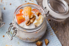 Healthy breakfast overnight oats with fresh fruit in a glass jar Stock Image