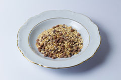 Healthy breakfast. Plate with muesli against white background Stock Photo