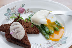 Healthy breakfast: poached egg, green beans, brown Stock Photo