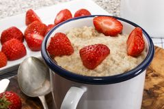 Healthy breakfast with porridge and strawberry royalty free stock image