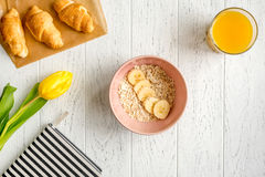 Healthy breakfast with porridge on wooden background top view Stock Image
