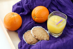 Healthy breakfast: portion of fresh made, freshly squeezed orange juice and oatmeal cookies Royalty Free Stock Photography