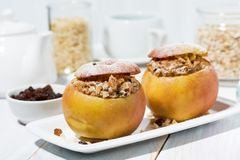 Healthy breakfast. portioned oatmeal with raisins baked in apple. Horizontal stock photo