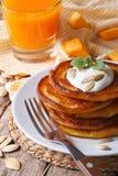 Healthy breakfast: pumpkin pancakes and juice closeup. Stock Photo