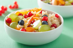 Healthy breakfast quinoa with fruits berry nectarine blueberry g Stock Image