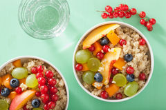 Healthy breakfast quinoa with fruits berry nectarine blueberry g Stock Photography