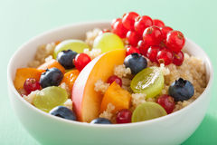 Healthy breakfast quinoa with fruits berry nectarine blueberry grape Royalty Free Stock Images