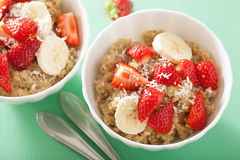 Healthy breakfast quinoa with strawberry banana coconut flakes Royalty Free Stock Images