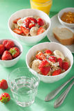 Healthy breakfast quinoa with strawberry banana coconut flakes Stock Image