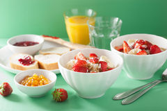 Healthy breakfast quinoa with strawberry banana coconut flakes Royalty Free Stock Photos