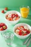Healthy breakfast quinoa with strawberry banana coconut flakes Stock Image
