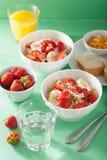 Healthy breakfast quinoa with strawberry banana coconut flakes Royalty Free Stock Image