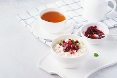 Healthy breakfast with rice porridge and cranberry confiture royalty free stock images