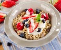 Healthy Breakfast with ripe  berries, yogurt , muesli. Stock Photo