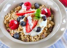 Healthy Breakfast with ripe  berries, yogurt , muesli. Royalty Free Stock Images