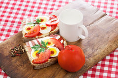 Healthy breakfast, sandwich and tomato from above Stock Photo