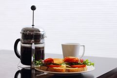 Breakfast with sandwich and coffee. Healthy breakfast with sandwiches and coffee in french press, scandinavian style royalty free stock image