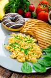 Healthy breakfast scrambled eggs with chive, panini toast Stock Photography