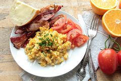 Healthy breakfast with scrambled eggs and fruits Royalty Free Stock Photo