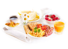 Healthy breakfast with scrambled eggs, juice and fruits Stock Images