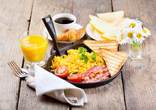 Healthy breakfast with scrambled eggs, juice and fruits Royalty Free Stock Image