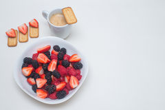 Healthy breakfast. Seasonal Berries The botanical definition of a berry is a fleshy fruit produced from a single flower and containing one ovary Royalty Free Stock Image