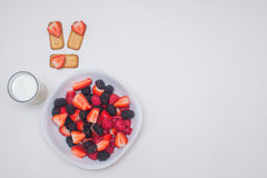 Healthy breakfast. Seasonal Berries The botanical definition of a berry is a fleshy fruit produced from a single flower and containing one ovary Stock Photos
