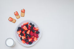Healthy breakfast. Seasonal Berries The botanical definition of a berry is a fleshy fruit produced from a single flower and containing one ovary Stock Photo