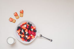 Healthy breakfast. Seasonal Berries The botanical definition of a berry is a fleshy fruit produced from a single flower and containing one ovary Stock Images