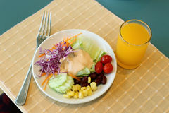 Healthy breakfast set, Fresh vegatable salad and orange juice Stock Photography