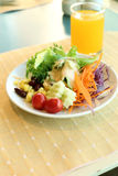 Healthy breakfast set, Fresh vegetable salad and orange juice Stock Images