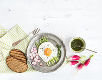 Healthy breakfast set. Fried egg with asparagus, radishes, green sauce and bread. Healthy breakfast set. Fried egg with green asparagus, radishes, green sauce Stock Photo