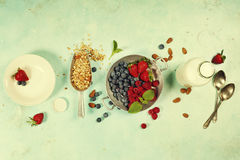Healthy Breakfast set with granola, almond milk and berries Stock Image