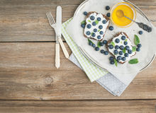 Healthy breakfast set with ricotta, fresh blueberries, honey and Stock Photo