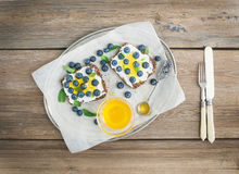 Healthy breakfast set with ricotta, fresh blueberries, honey Stock Photography